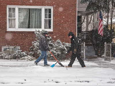 James Neiss/staff photographer  North Tonawanda, NY - Father and Son Martin Vinda, right and Matthew, left, double team clearing the sidewalk in front of their Oliver Street home. The Vinda's said they wanted to get on it early and keep it clear all day.
