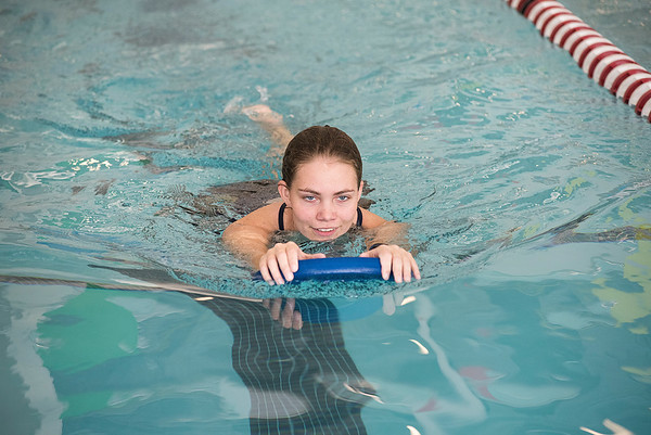 James Neiss/staff photographer <br /> Lockport, NY - It might be freezing outside, but Sommer Newson of Lockport stays warm doing a few laps in the pool at the Lockport Family YMCA.