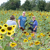 James Neiss/staff photographer <br /> Sanborn, NY - The England family of Hamburg, Sarah, 14, John and Joanne, enjoyed a sunny outing at the Sunflowers of Sanborn.