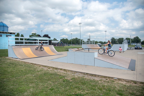 James Neiss/Staff Photographer<br /> Lockport, NY - Grandma Marie Stanton keeps an eye on Ryler Stanton, 7, and his sister Liliana, 9, who were enjoying the afternoon playing at the Lockport Skate Park.