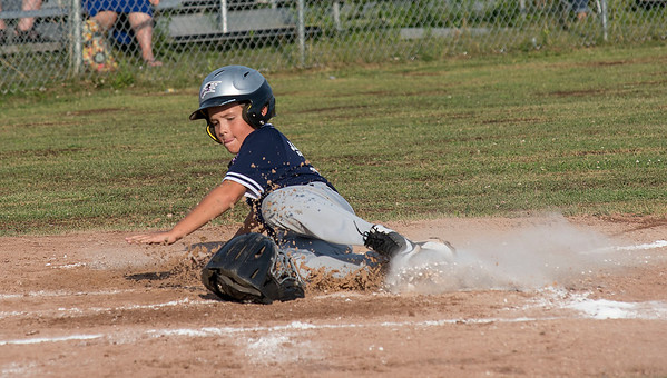 James Neiss/Staff Photographer<br /> Niagara Falls, NY - Yankees #99 Andrew Heigl slides into home for a run in the first inning.