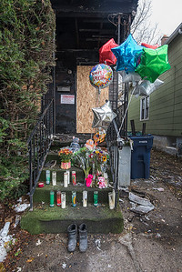 James Neiss/staff photographer  Niagara Falls, NY - A memorial to the victim of a house fire on Ashland Avenue adorns the steps to the burned out house.