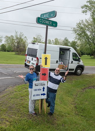 """James Neiss/staff photographer <br /> Newfane, NY - Rout Sign Coordinator Michelle Scinta had help from her father-in-law Roy Scinta putting up signs at the corner of Lake and Coomer Roads in the Town of Newfane for this Saturday's Tour de Cure. The event features bicycles, runners and walkers raising donations for the American Diabetes Association. The event kicks off 6 a.m. at Niagara University's Dwyer Arena followed by the 100 mile ride at 7 a.m.<br /> <br /> For more information visit: <a href=""""http://www.diabetes.org/buffalotour"""">http://www.diabetes.org/buffalotour</a>"""
