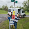 "James Neiss/staff photographer <br /> Newfane, NY - Rout Sign Coordinator Michelle Scinta had help from her father-in-law Roy Scinta putting up signs at the corner of Lake and Coomer Roads in the Town of Newfane for this Saturday's Tour de Cure. The event features bicycles, runners and walkers raising donations for the American Diabetes Association. The event kicks off 6 a.m. at Niagara University's Dwyer Arena followed by the 100 mile ride at 7 a.m.<br /> <br /> For more information visit: <a href=""http://www.diabetes.org/buffalotour"">http://www.diabetes.org/buffalotour</a>"