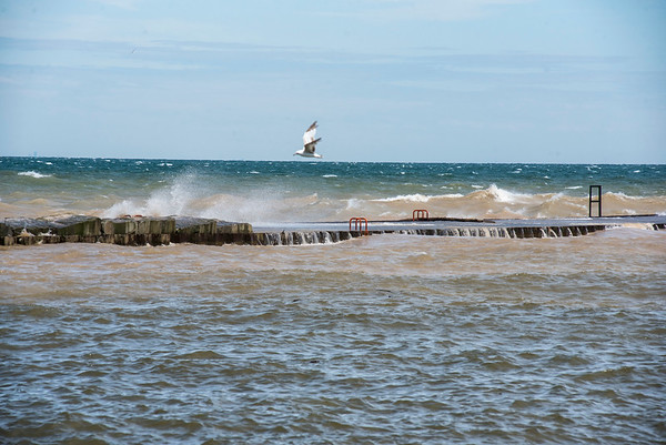 James Neiss/staff photographer <br /> Wilson, NY - High winds drive the waves over the piers at Wilson Harbor on Friday.