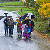 James Neiss/staff photographer <br /> Lockport, NY - Kelsie Kirkpatrick, 9, Skyler Lee, 6, and Cash Lee, 9, and their families, didn't let the rainy weather dampen their Halloween. The pack was last seen going door-to-door on Amelia Street in Lockport.