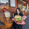 James Neiss/staff photographer <br /> Lewiston, NY - Lexi Alfiere, general manager of the Silo Restaurant in Lewiston, shows off the Double Silo Burger with cheese and bacon.