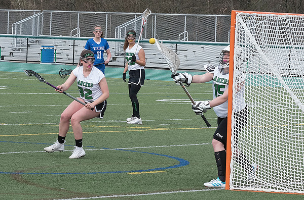 James Neiss/staff photographer <br /> Lewiston, NY - Lewiston-Porter goalie #15 Ashlynn Gordon makes a save in girls Lacrosse game action against Grand Island at Lew-Port.