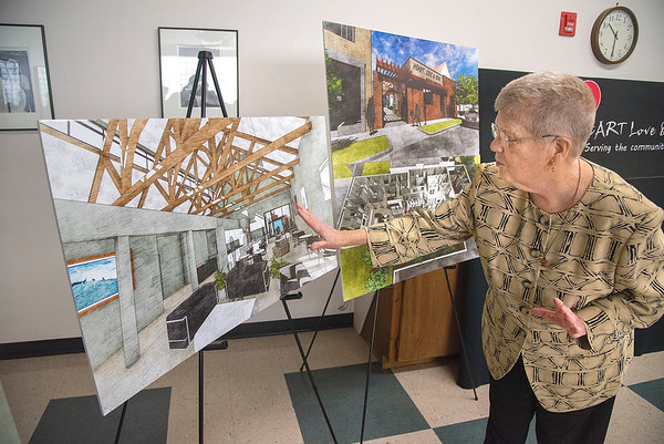 James Neiss/staff photographer <br /> Niagara Falls, NY - Sister Beth Brosmer shows off renderings of the new $2.6M Daybreak program and facility addition to be built at Heart Love & Soul.