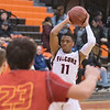 James Neiss/Staff Photographer<br /> Buffalo, NY - Niagara Wheatfield #11 Davon Ware looks to pass the ball go in during sectional basketball game action against Williamsville East. Sixth-seeded Niagara-Wheatfield makes its first Section VI semifinal appearance since 2005, taking on No. 7 Will. East in Class A-1 at Buff State.