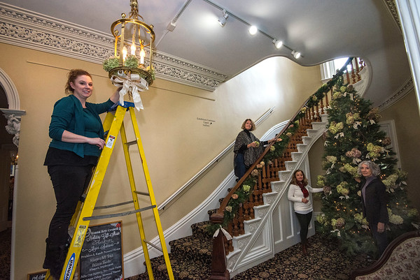 James Neiss/staff photographer <br /> Lockport, NY - Members of the Kenan Arts Council, Heather Lindquist, Joan Winter, Kathy Killion and Jane Corser deck the halls of the Kenan Mansion in preparation for the annual Holiday Gift Show.