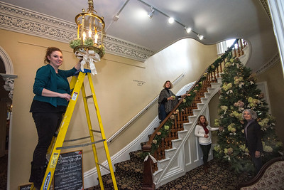 James Neiss/staff photographer  Lockport, NY - Members of the Kenan Arts Council, Heather Lindquist, Joan Winter, Kathy Killion and Jane Corser deck the halls of the Kenan Mansion in preparation for the annual Holiday Gift Show.