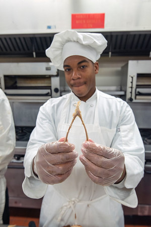 James Neiss/staff photographer <br /> Sanborn, NY - BOCES Culinary Arts & Commercial Baking major Mark Wilson, of Niagara Falls High School save a wishbone as he and fellow students prepare turkey and all the fixings for a dinner at the Salvation Army.