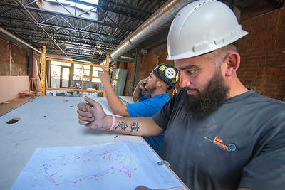 James Neiss/staff photographer  Niagara Falls, NY - Project manager Randy Lada and installer Robert Batz work on the fire suppression systems as construction work continues at 616 Niagara.