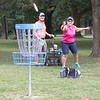 James Neiss/Staff Photographer<br /> Lockport, NY - Jack Jackson the dog watches as Brad Jackson and his wife Louise Bartels play a round of disk golf at the new course at Outwater Memorial Park in Lockport.