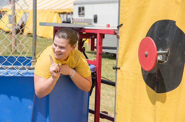 James Neiss/Staff Photographer<br /> Lockport, NY - Megan Currie of Lockport, playfully scolds Jeremy Chesterfield of Wilson, for dunking her into the cold Karate Ken's Dunk Tank at the Niagara County Fair.