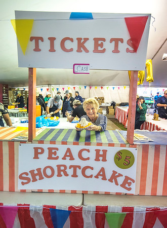 James Neiss/staff photographer <br /> Lewiston, NY - Volunteer Shirley Berrigan wants you to come get a Peach Shortcake at the Lewiston Kiwanis tent at the Niagara County Peach Festival. The 62nd Annual Niagara County Peach Festival, hosted by the Lewiston Kiwanis, is in full swing this weekend with food, entertainment, rides and fun for all.