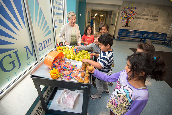 James Neiss/staff photographer <br /> Niagara Falls, NY - GJ Mann Elementary food service worker Pat Kline is all smiles as children line up at the schools fruit cart for a healthy snack. Elementary and intermediate schools in the Niagara Falls school district each have a cart where students can get free fruit and vegetable snacks, said Kline.