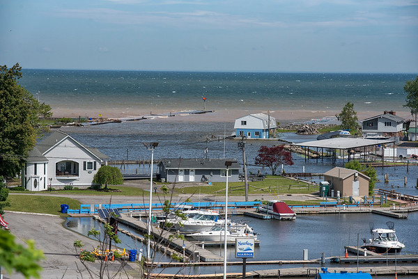 James Neiss/staff photographer <br /> Olcott, NY - High winds drive the waves over the piers in Olcott on Friday.