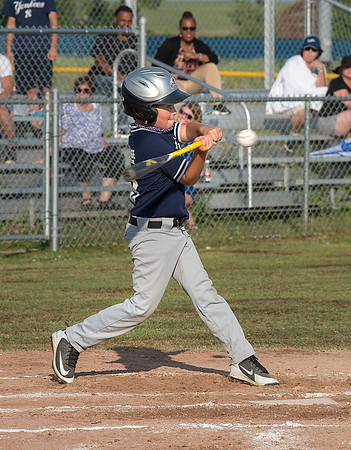 James Neiss/Staff Photographer<br /> Niagara Falls, NY - Yankees #99 Andrew Heigl swings at the ball in the 1st inning of baseball championship game action against the Red Sox. Heigl eventually made a run.