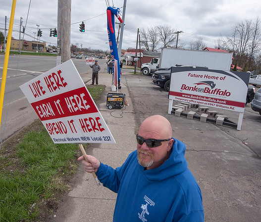 James Neiss/staff photographer <br /> Niagara Falls, NY - Electrical Workers IBEW Local 237 members protested at the ceremonial groundbreaking at the future location of Bank On Buffalo at 7121 Niagara Falls Blvd. during a ceremonial groundbreaking there.