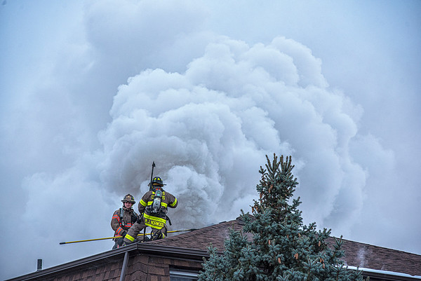 James Neiss/staff photographer <br /> Lockport, NY - Firefighters vent the roof of a Robinson Road apartment building fighting a fire that broke out there.