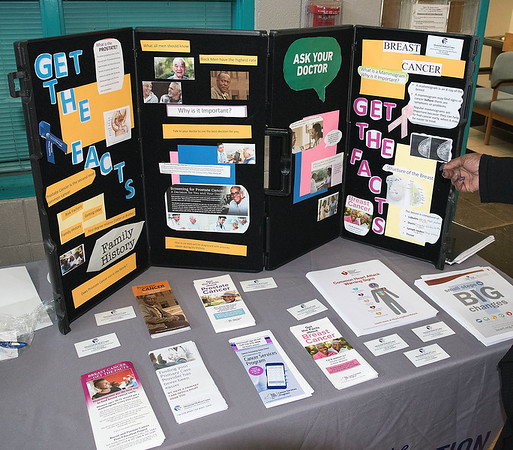 James Neiss/Staff Photographer<br /> Niagara Falls, NY - Niagara Falls Memorial Medical Program Coordinator Cassandra Jackson was on had to talk about health issues at her booth during the free SUNY ATTAIN Lab and Niagara Falls Housing Authority Resource Fair at the Doris Jones Resource Center.