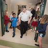 James Neiss/staff photographer <br /> Newfane, NY - Nine year old Chase Bell, a fourth grader at Newfane middle school engages  in conversation with veteran Stan Johnson, a past commander of Newfane American Legion Post 873, as he escorts him to a seat for lunch. Newfane Elementary 3rd and 4th grade student senate members hosted a veterans luncheon at the Newfane community center on  Wednesday.
