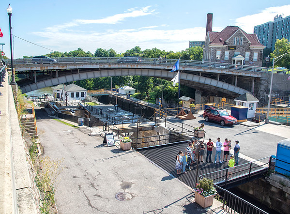 James Neiss/Staff Photographer<br /> Lockport, NY - A tour group stops over the Flight of Five historic locks for an explanation on how the locks function.