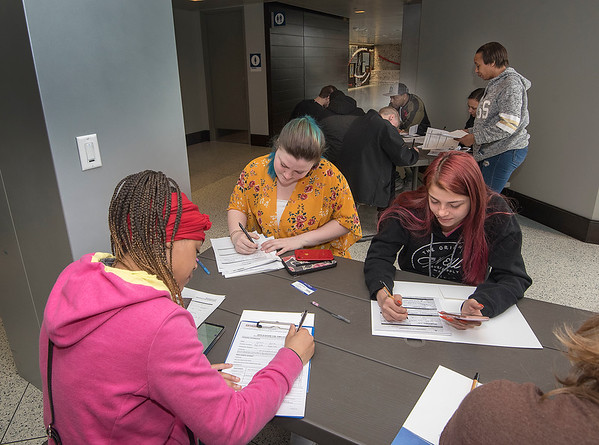 James Neiss/staff photographer <br /> Niagara Falls, NY - Job seekers fill out applications at a Hospitality Job Fair.  More than 25 downtown Niagara Falls businesses joined together and hosted a collaborative Hospitality Industry Job Fair at the Niagara Falls Train Station.