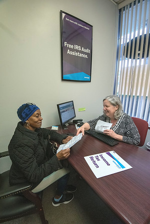 James Neiss/staff photographer <br /> Lockport, NY - Down to the Wire - Lockport Jackson Hewitt tax preparer Kathleen Baker works on Thelma McClains income tax return on due day.