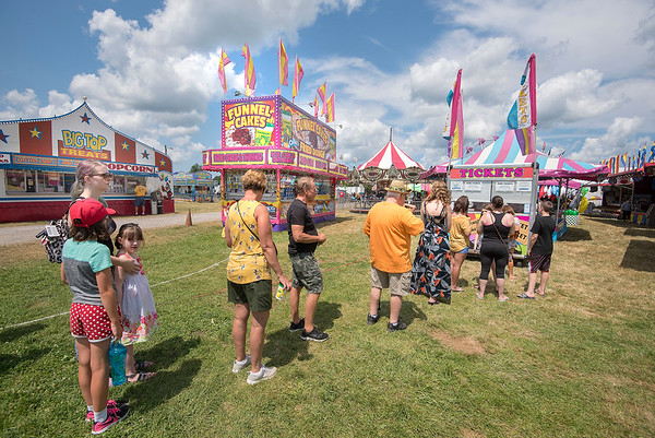 James Neiss/Staff Photographer<br /> Lockport, NY - Thrill seekers were lining up for ride ticket at the Niagara County Fair.