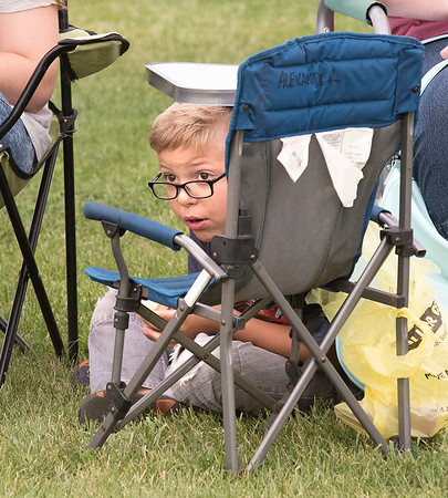 James Neiss/staff photographer <br /> Wilson, NY - A passing sprinkle didn't distract Easton Taylor, 6, of Barker, from taking in the game action watching his sister Ginger Alexander play for the Barker varsity field hockey team as they played against Wilson.