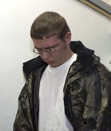 030320 Cummings,Kyle  *Photo by Dennis Stierer/ Lockport  - Suspect Kyle A. Cummings head into Niagara County Court.