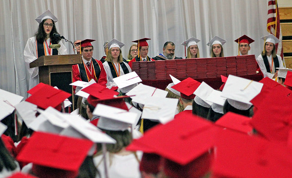 Roger Schneider | The Goshen News<br /> Aameneh Kermani looks over a sea of red and white graduation caps as she speaks Sunday during the Goshen High School graduation ceremony.
