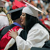 Roger Schneider | The Goshen News<br /> Maria Salazar hugs Jeremy McLaughlin, Goshen High School counselor, while on the way to receive her diploma Sunday.