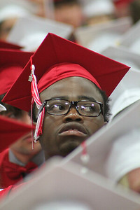 Roger Schneider | The Goshen News Kevon Coleman tucked his tassle behind his eyeglasses to keep it from swinging around as he watches the crowd Sunday at the Goshen High School graduation ceremony.