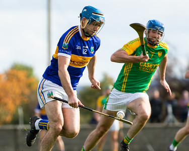 Kiladangan's Joe Gallagher on the attack watched by Toomevara's Luke Ryan in the Tipperary Senior Hurling Quarter final in Cloughjordan