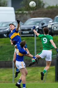 Tipperary's Tom Tobin and Paddy Creedon, Limerick's Michael Southgate during the Munster Minor Football Championship