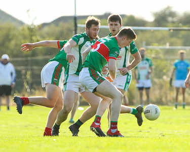 Loughmore Castleiney's John Meagher against Cahir's Dean Lonergan and Niall McKenna