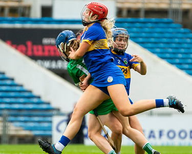 Limerick's Dearbhla Egan is brought down for a penalty by Tipperary's Julieanne Bourke and Karen Kennedy