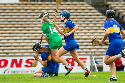 Tipperary Goalkeeper Caoimhe Bourke challenges Limerick's Rebecca Delee
