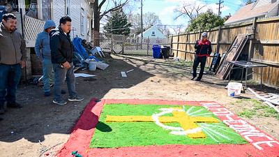 Members of Alfo-Conce building an alfombra, Spanish for carpet in Arlington March 30.