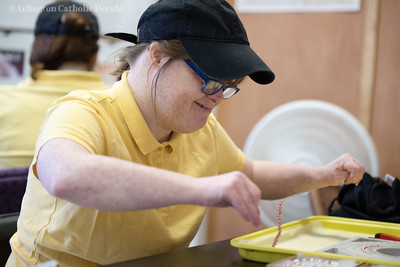 Workers prepare food at Wildflour in Chantilly, VA June 19, 2019