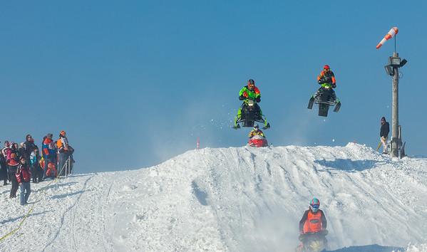 03,DA029,DJ,onlookers enjoy Sunny skies 50 degree temps and snowmobile racing