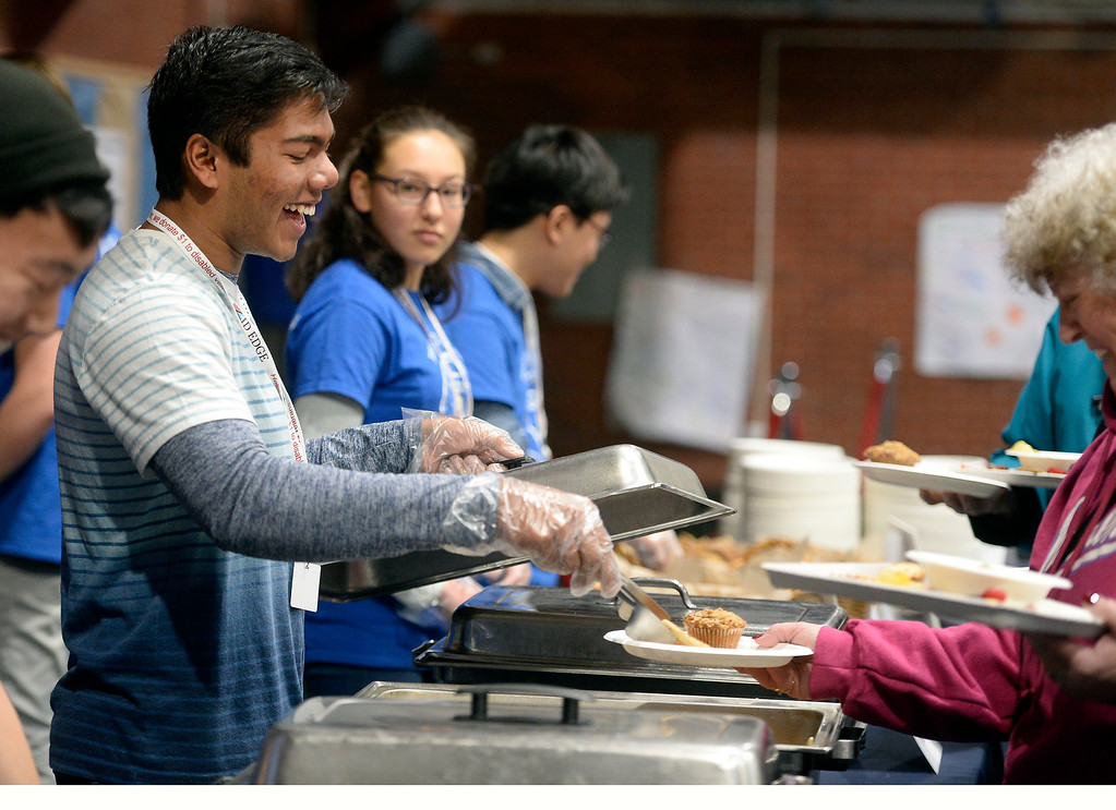 . LAFAYETTE, CO - January 12, 2019: Sohan Sur, a Peak to Peak student, laughs aftermissing the mark with a pancake during the annual Lafayette Oatmeal Festival on Saturday. For more photos, go to dailycamera.com. (Photo by Cliff Grassmick/Staff Photographer)