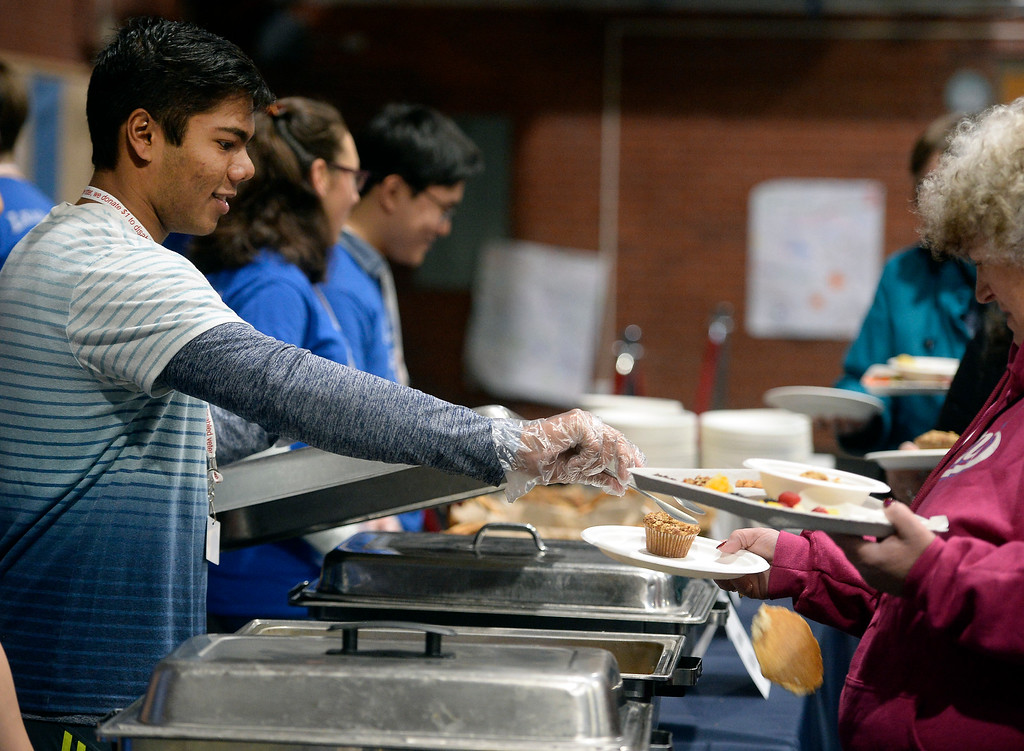 . LAFAYETTE, CO - January 12, 2019: Sohan Sur, a Peak to Peak student, misses the mark with a pancake during the annual Lafayette Oatmeal Festival on Saturday. For more photos, go to dailycamera.com. (Photo by Cliff Grassmick/Staff Photographer)