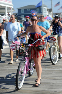 Several hundred persons participated in the Patriotic Bicycle Parade, many dressed in costume, held on the boardwalk in Lavallette, NJ on 07/04/2019. (STEVE WEXLER/THE OCEAN STAR).