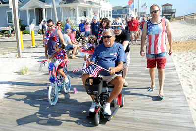The Pastriotic Bicycle Parade in Lavallette, NJ attracted several hundred participants, on the boardwalk, in Lavallette, NJ on 07/04/2019. (STEVE WEXLER/THE OCEAN STAR).
