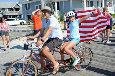 Several hundred persons participated in the Patriotic Bicycle Parade held on the boardwalk in Lavallette, NJ on 07/04/2019).